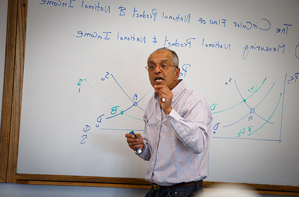 Professor Reza Ramanzani teaches a class during Accelerated Summer College at Saint Michael's.