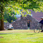 student biking on campus at Saint Michael's College